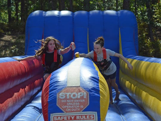 Brianna Giovanelli, 13, of Northfield and Haley Taggart, 13, also of Northfield compete in the bungee run during Community Day at Atlantic Cape Community College.