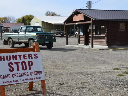 Hunters pull into the check station in Augusta. The station is unique as one of the only permanent big game check stations in Montana.