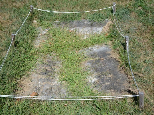 The gravestone of James Kent is shown prior to restoration