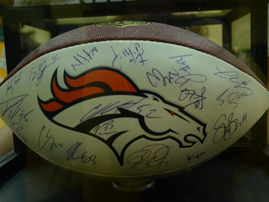 A football signed by the Denver Broncos nabbed $5,000 in a fundraiser for Trayson Harrell. The football features the signatures of the Denver Broncos team, including Peyton Manning.