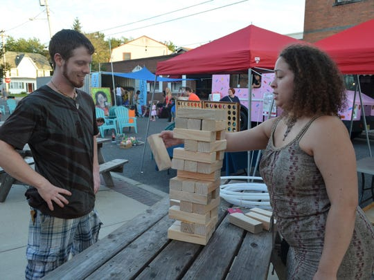 Kevin Carr of Laurel Springs and Victoria Ortiz of Philadelphia play a game during the New Jersey Fringe Festival last year in Hammonton.