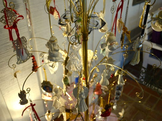 Jo Hines keeps an ornament tree filled with angels in memory of her daughter Sally Hines. The tree remains up year round.