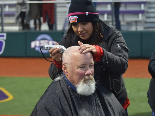 LC baseball head coach Mike Byrnes has his head shaved in between a doubleheader at Concordia University in Texas to support those fighting cancer, including his wife Colinda, who Byrnes said watched from home on the computer.