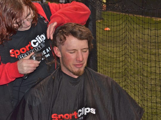 LC senior baseball player Brand Bignar has his head shaved in between a doubleheader at Concordia University in Texas to support those fighting cancer.