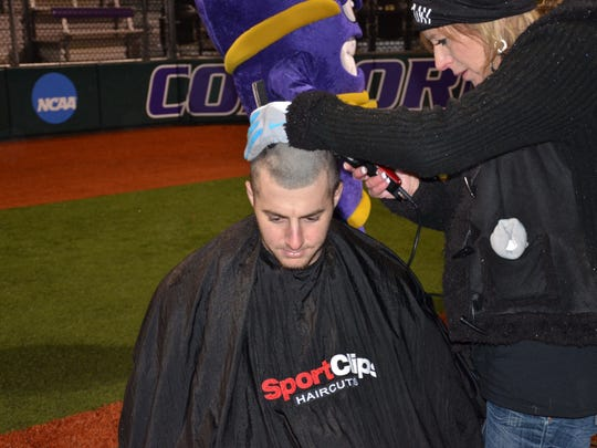 LC senior baseball player Ron Anders has his head shaved in between a doubleheader at Concordia University in Texas to support those fighting cancer.