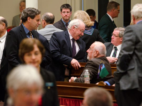 Legislators talk before Wednesday's House vote on whether to support a bill that could make Vermont the first state to require labeling of foods that contain genetically modified organisms. The House voted 114-30 in support of the bill.