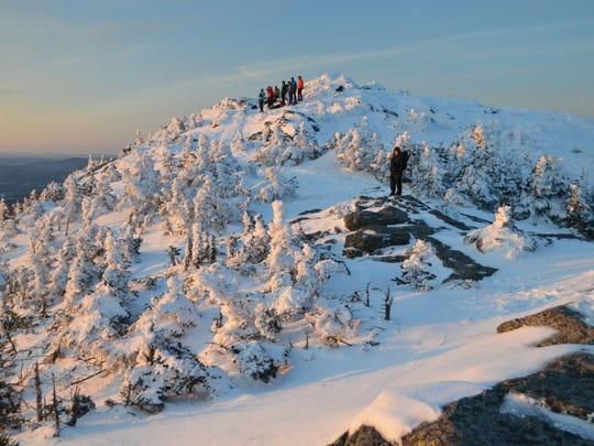 Sunrise on a snowy Easter morning atop Camels Hump.