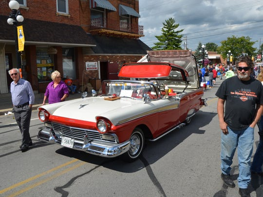 Visitors to the annual Clyde Fair Sunday take a long look at one of the classic cars on display along Main Street.