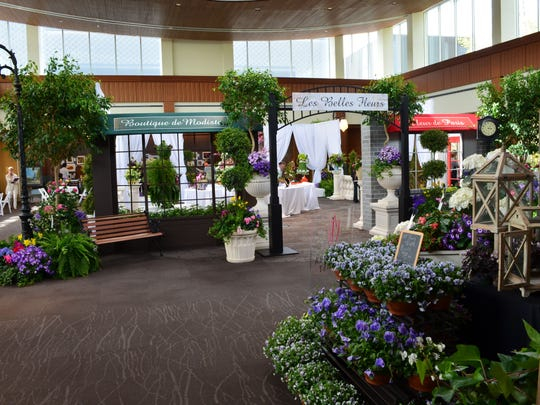 Les Belles Fleurs is a Garden Club of America flower show featuring French and circus-related themes.