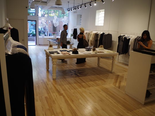 Customers visit Sicily Boutique, 115 S. Dubuque St., on Friday.