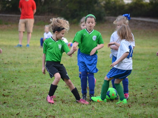 Children participate in the first day of the city-sponsored youth soccer league.