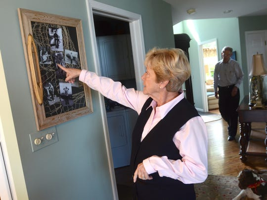 Sue Smith points to a piece of art remembering her