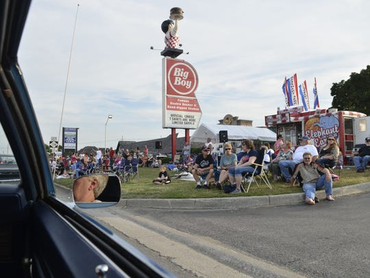 Cruise Night participants watch cars on M-25 in Port Huron.