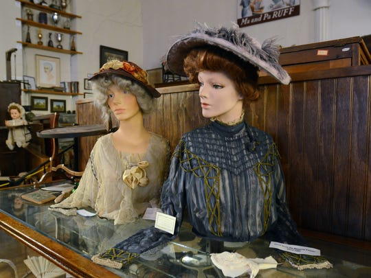 Period clothing is displayed in the St. Clair museum.