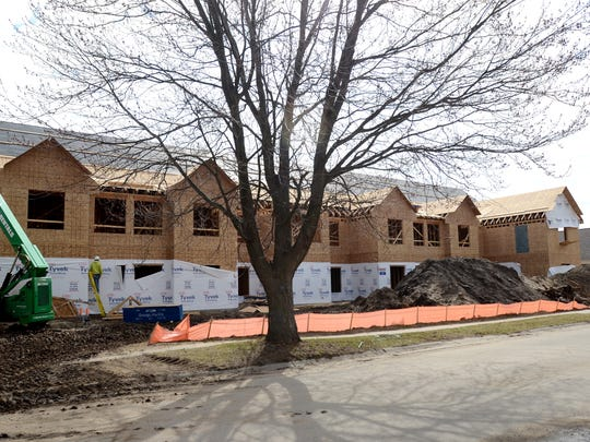 Work continues Mon, April 6, at the future Baker College student housing in Port Huron.