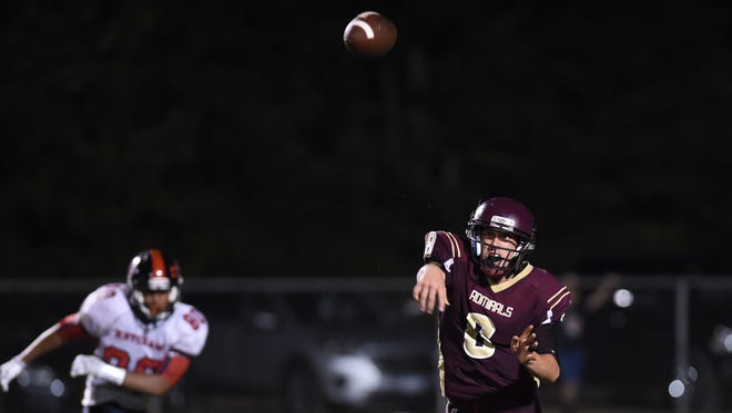 Arlington High School quarterback Austin Heck throws a pass against Roy C. Ketcham during a Sept. 2016 game.