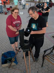 Pensacola State College astronomy professor Wayne Wooten, right, and Tammy Savol prepare for a night of stargazing on March 31, 2017, at Casino Beach in Pensacola.