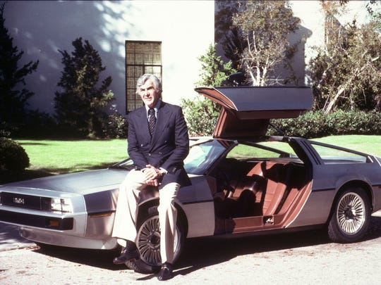 A classic promotional photograph of John DeLorean with
