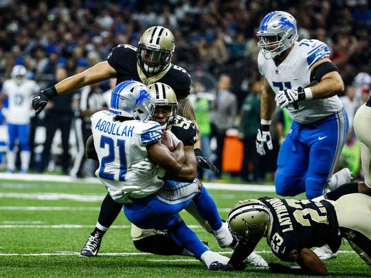 Oct 15, 2017; New Orleans, LA, USA; Saints linebacker Craig Robertson (52) tackles Lions running back Ameer Abdullah in the first quarter of a game at the Mercedes-Benz Superdome.