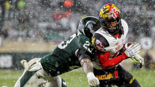 Maryland Terrapins wide receiver D.J. Moore (1) is tackled by Michigan State Spartans linebacker Chris Frey (23) during the second half of a game at Spartan Stadium.