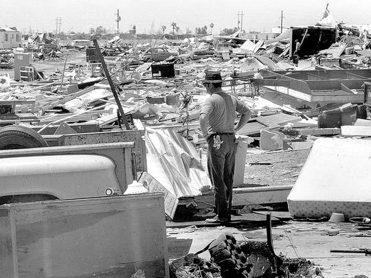 In this 1970 file photo, a man surveys the damage after Hurricane Celia struck Corpus Christi.