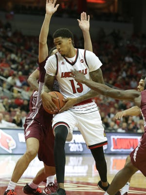 Louisville's Ray Spalding fights to control the ball against SIU defenders. Nov. 21, 2017.