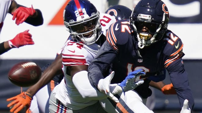 Giants cornerback James Bradberry (24) defends against Bears wide receiver Allen Robinson (12)  in Chicago on Sunday.