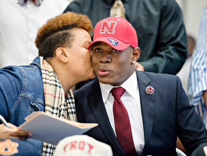 Cameron Taylor receives a kiss from his mother, Courtney