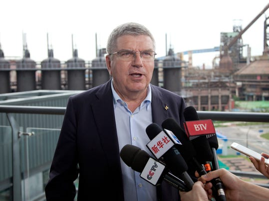 """International Olympic Committee President Thomas Bach speaks during an interview at the headquarters of the Beijing 2022 Winter Olympics Organizing Committee in Beijing, Saturday, Aug. 26, 2017. Bach said Saturday he sees """"no reason for any immediate concern"""" about tensions on the Korean Peninsula affecting next year's Winter Olympics in Pyeongchang, South Korea. (AP Photo/Christopher Bodeen)"""