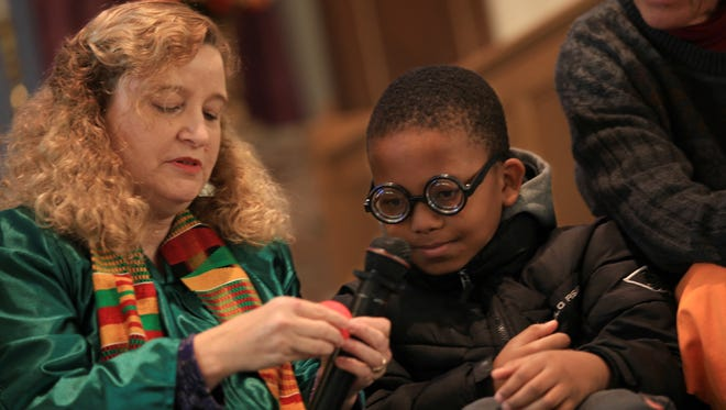 The Rev. Wendy Fambo gives glasses and a red nose to Tay'Von Betts, 10, during a service at Immanuel Baptist Church on Nov. 13, 2016. Rev. Fambo emphasized the importance of humor and fun when trying to improve our state of mind and devotes some time during service to act silly and laugh.