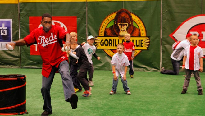 Dmitri Young winds up on the Reds Rookie Field during Redsfest in 2013.