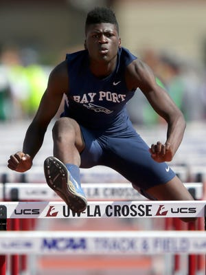 Bay Port sophomore Cordell Tinch races in the 110-meter hurdles during the WIAA state track and field tournament on June 3 in La Crosse. Tinch led the local track and field honor roll this season in four events.