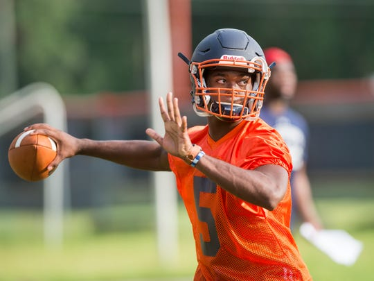 Quarterback Z'khari Blocker looks for a receiver during football practice at Escambia High School in Pensacola, FL on Monday, August 1, 2016. Blocker played for Independence Community College during filming of Last Chance U Season 4 in the 2018-19 season.