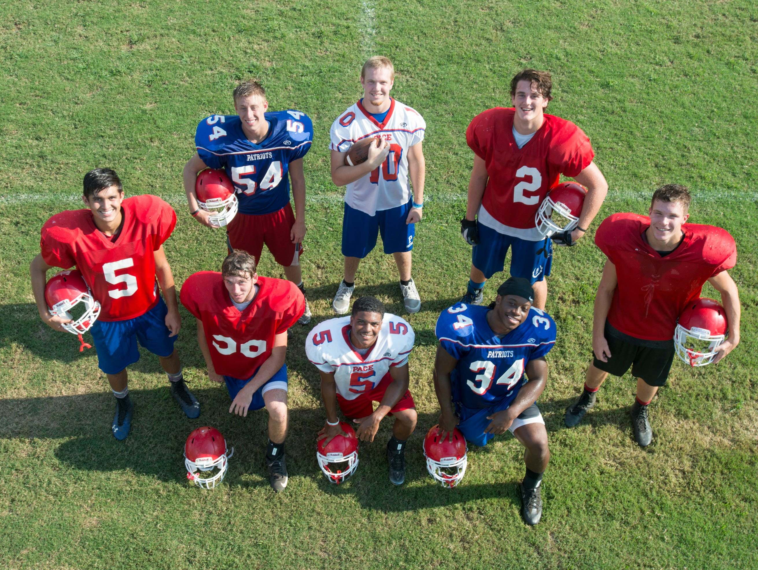 Clockwise from left: Scott Marshman (5), Spencer Hill (54), Jaxon Adams (10), Bailey Clark (2), Cameron Bozeman, Anthony Johnson (34), Tony Gibson (5), and Riley Fields (56) during Pace High School football practice on Wednesday, August 3, 2016.