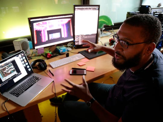 Animator Justin Lee works on a segment of the Lumenocity light show in Adobe AfterEffects at the Lightborne studio. Lee brings together animation and sound in synchronization to be projected on the interior of the Taft Theatre.