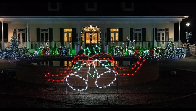 The December Nights & Holiday Lights extravaganza will be a drive-through event this year because of the COVID-19 pandemic. Shown is the visitor's building at the Coastal Georgia Botanical Garden in this file photo.