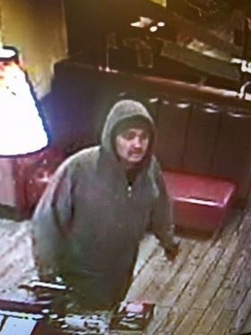 Call authorities with tips related to a robbery Thursday, Dec. 28, 2017 of Denny's restaurant on Bataan Memorial West in Las Cruces. A suspect in the incident is seen here in security camera footage from the restaurant.