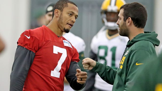 Green Bay Packers quarterback Brett Hundley (7) fist bumps during practice inside the Don Hutson Center Wednesday, November 15, 2017 in Ashwaubenon, Wis.