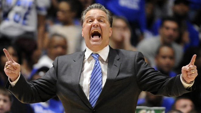 Kentucky Wildcats head coach John Calipari yells to his team during the second half of the SEC Men's Basketball Tournament game against the Georgia Bulldogs at Bridgestone Arena, Saturday, March 12, 2016, in Nashville, Tenn.