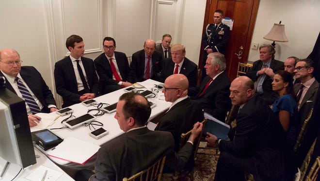 In this image provided by the White House, taken April 6, 2017, Deputy National Security Adviser Dina Powell, right,  joins President Donald Trump, and others, as he receives a briefing on the Syria military strike from his National Security team after the strike at Mar-a-Lago in Palm Beach, Fla.