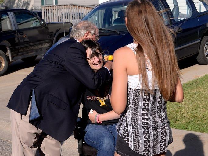 Michelle Garn cries as she hugs Tom Kolassa Tuesday,