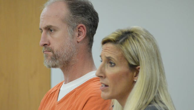 Kyland Hudson with his attorney, Jennifer Kuiper-Weise.