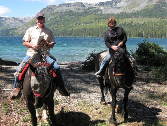Terry and Jane Conway ride through the National Forest