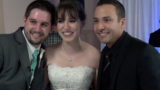Ryan and A'riel Kastovich with Howie Dorough of the Backstreet Boy at their wedding on Saturday.