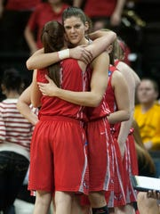 Marist College's Tori Jarosz hugs Leanne Ockenden, during the women's basketball team's NCAA tournament loss at Iowa in March 2014.