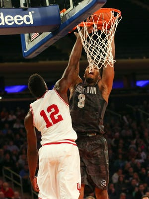Georgetown Hoyas forward Mikael Hopkins (3) shoots over Indiana Hoosiers forward Hanner Mosquera-Perea (12) during the first half at Madison Square Garden.