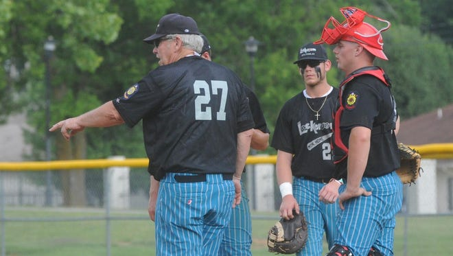 Lockeroom head coach Lester White (27) makes a visit to the mound during a recent game against Harrison. Also pictured are, from left, Brody Ninemire, Sky-Lar Culver and Cole Anderson. Lockeroom hosts the 29th edition of the Twin Lakes Classic, beginning Wednesday at Cooper Park.