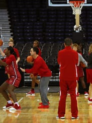 Louisville's coach Jeff Walz runs some drills during