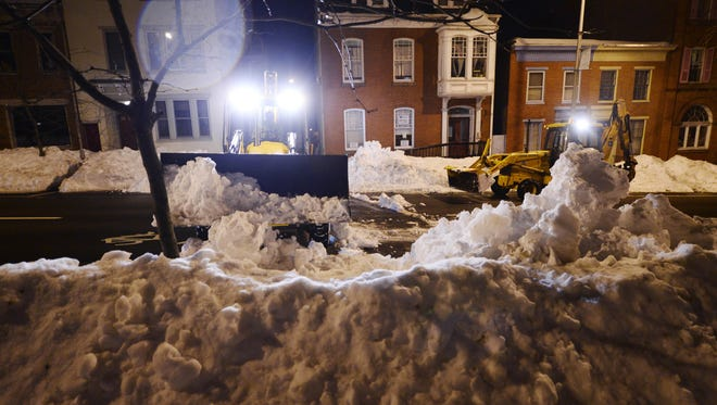 York city workers clear snow from Home Way in York on Jan. 26. Crews worked 12-hour shifts around the clock dealing with the approximately 30 inches of snow that blanketed the city.