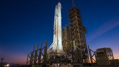 SpaceX's Falcon 9 rocket stands on historic pad 39A